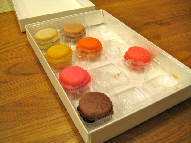 Small, brightly colored macaroons in a box
