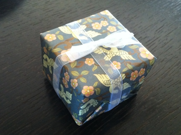 Small box wrapped in floral paper and tied with a bow
