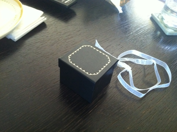 Small black box with gold decoration on lid
