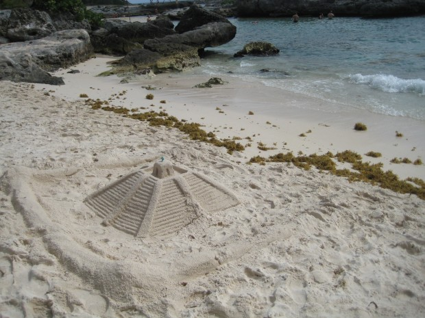 Mayan pyramid made of sand at the seashore