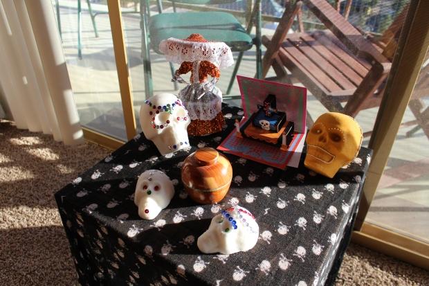 Ofrenda with sugar skulls and Katrina