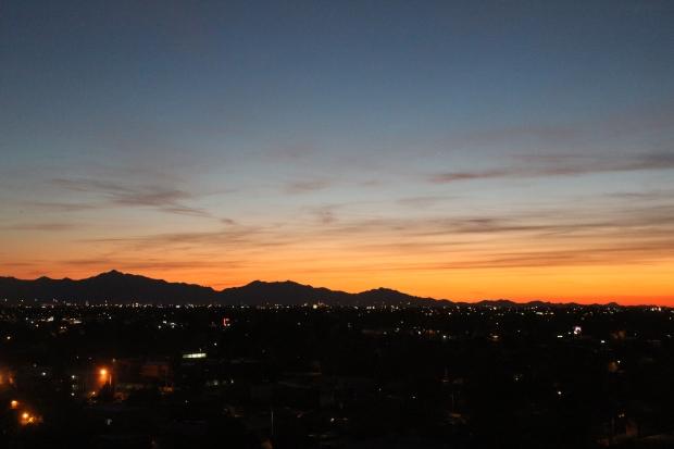 Orange sunset over mountains in Phoenix, AZ