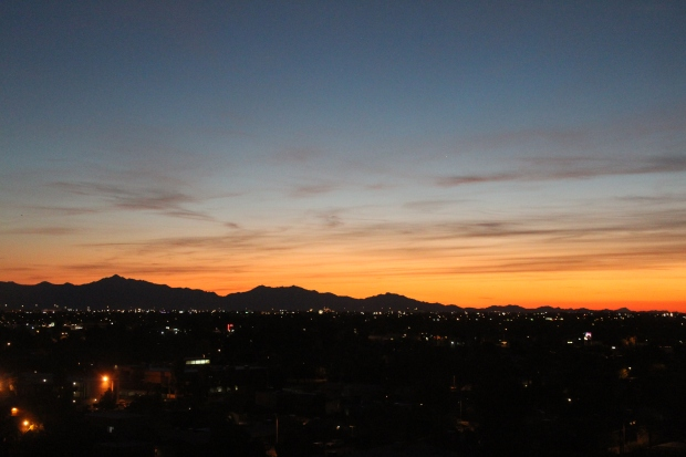 Orange sunset over mountains in Phoenix, AZ