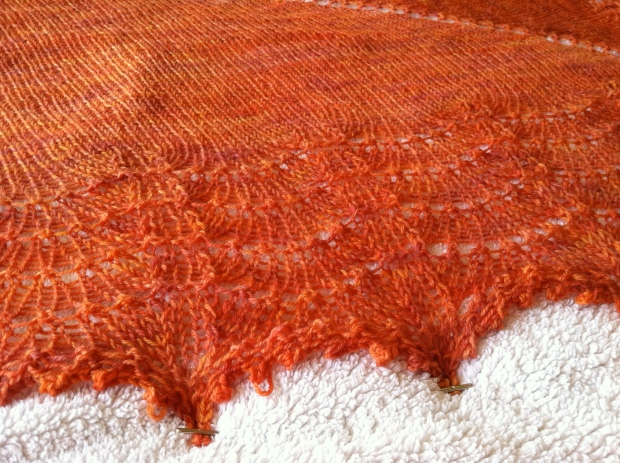 Coral-colored lace shawl