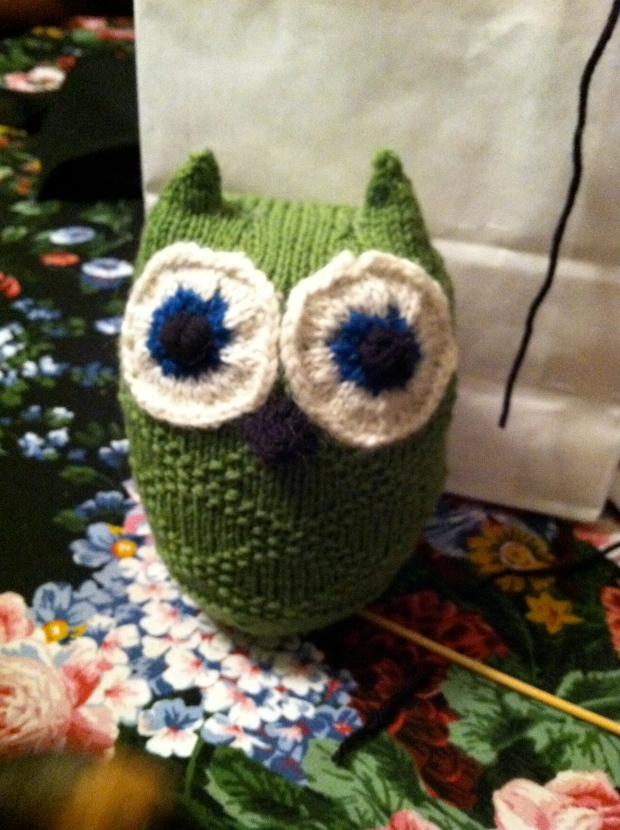 Knitted green owl.