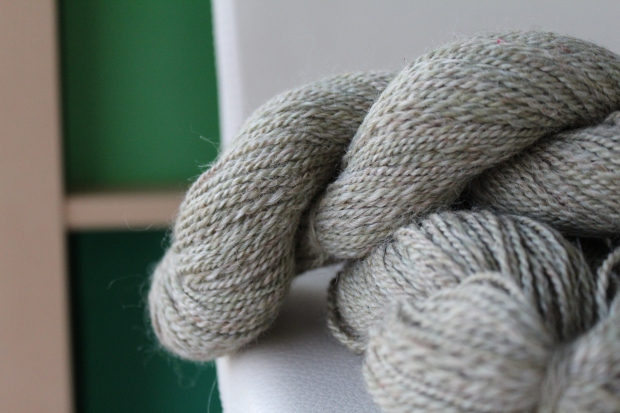 Skein of pale green tweed yarn