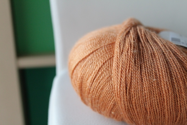 Skein of wheat-colored laceweight