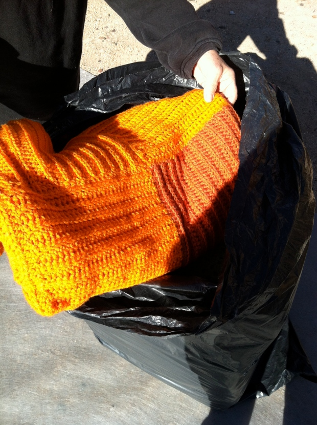 First orange blanket coming out of a bag