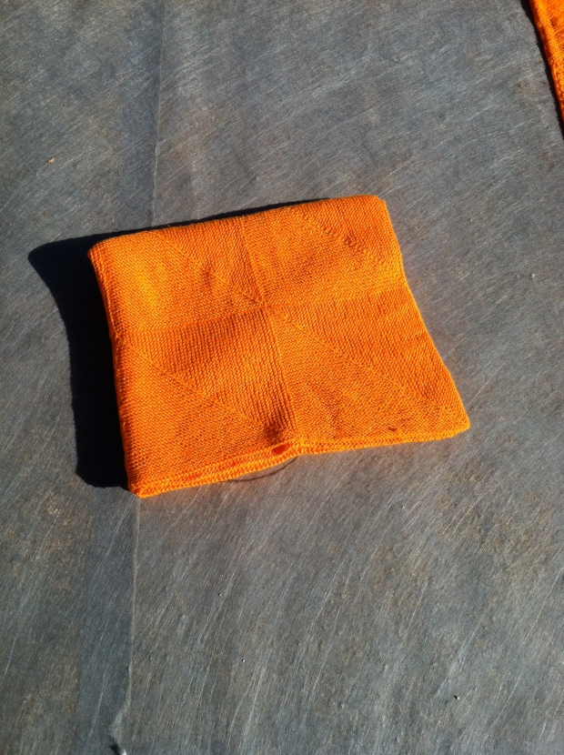 Folded orange blanket