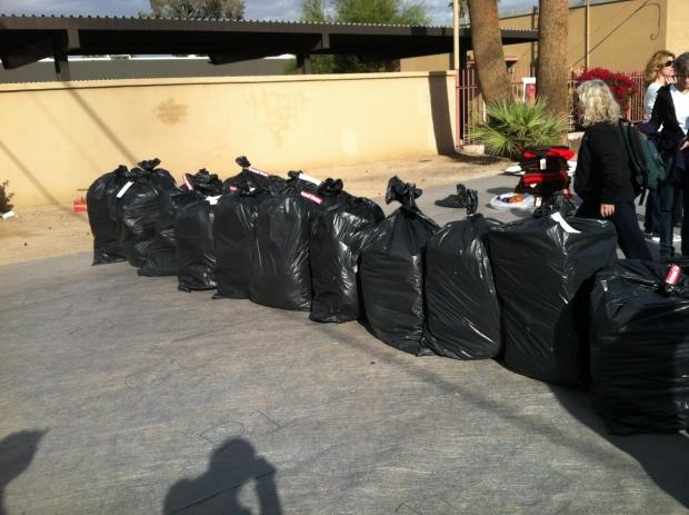 Black plastic bags holding blankets
