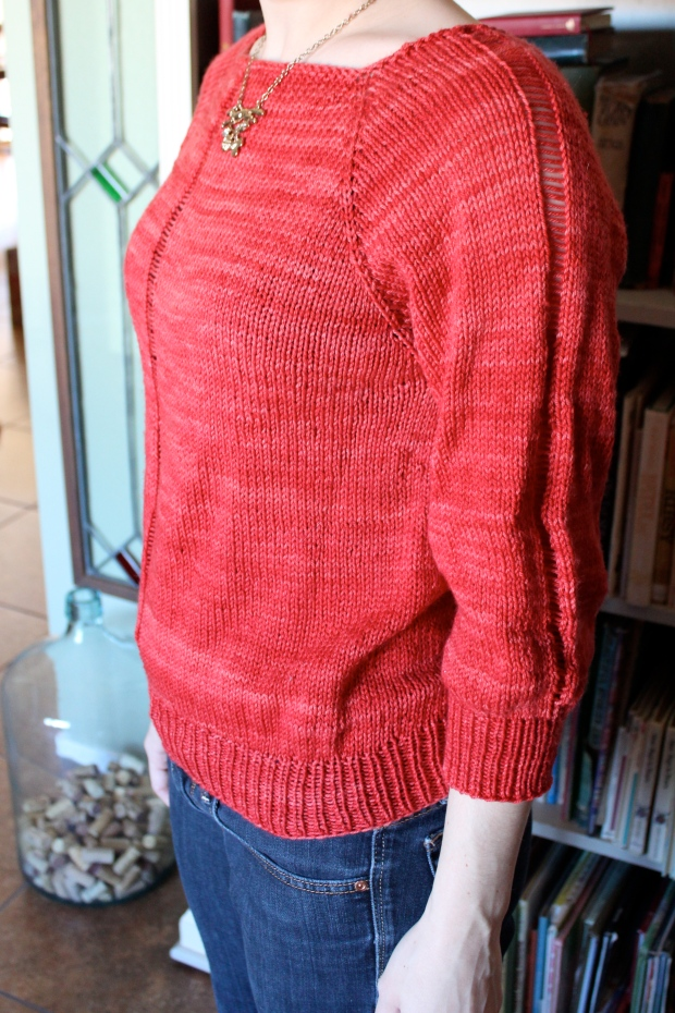 Woman modeling a red sweater