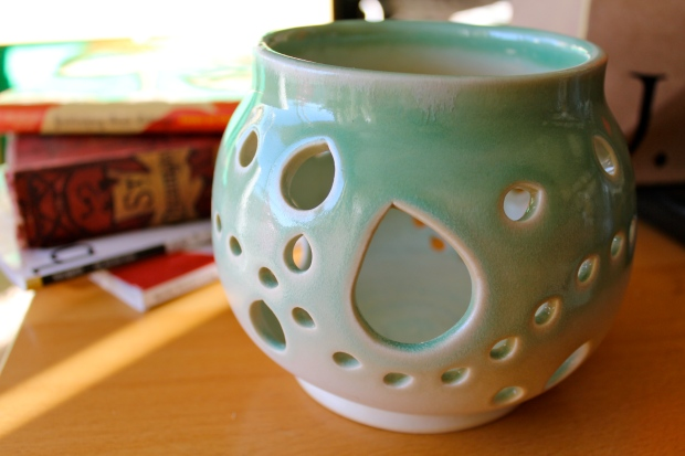Turquoise yarn bowl with many cutouts