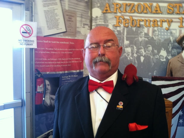 Red knitted mouse on Governor George W.P. Hunt reenactor's shoulder