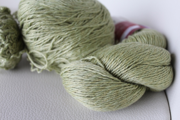 One skein and one ball of pale green yarn