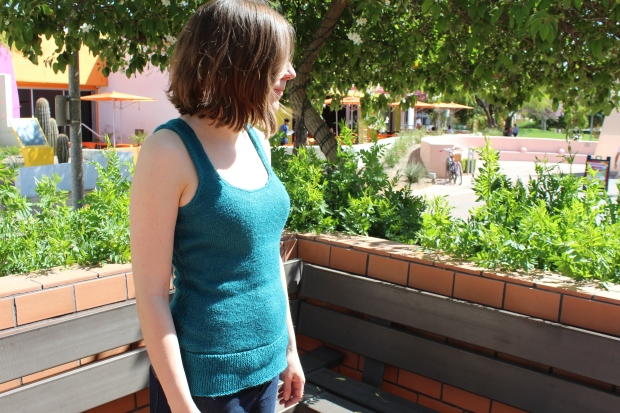 Girl wearing a teal knitted tank top