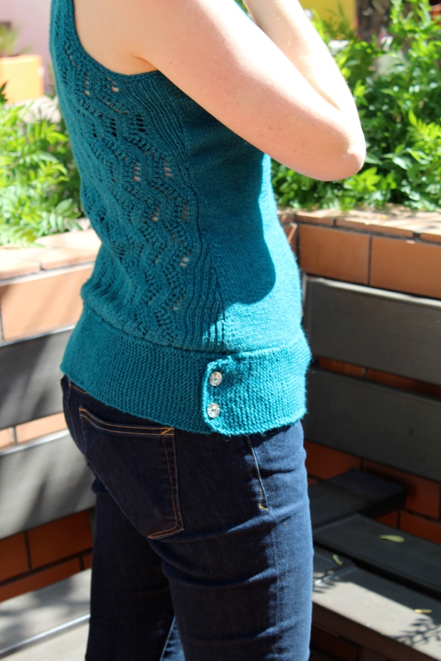 Waist detail of knitted teal tank top