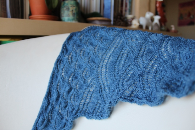 Blue knitted stole on a white chair