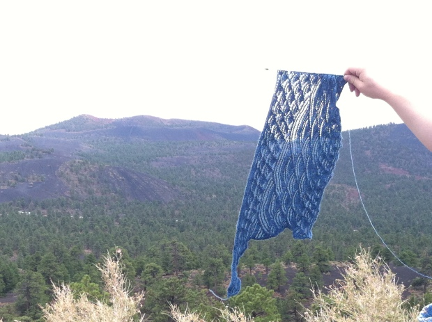 High Seas shawl in front of a cinder cone volcano