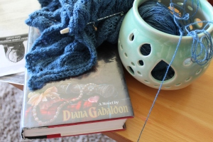 Original edition of Outlander and a knitted shawl