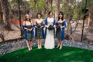 Bride and bridesmaids wearing blue knitted lace shawls
