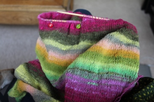 Brightly colored knitting with Noro yarn.
