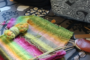 Brightly colored knitted top in progress