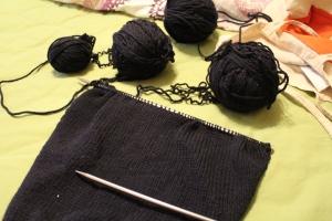 Dark blue knitting on lime sheet