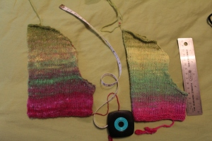 Brightly colored knitted sleeves on a lime green sheet