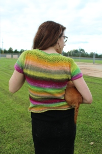 Woman wearing a brightly striped sweater top