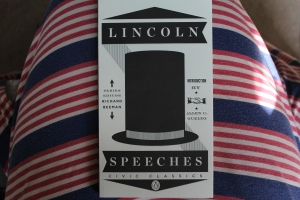 Black and white copy of Lincoln's speeches on a red, white, and blue dress
