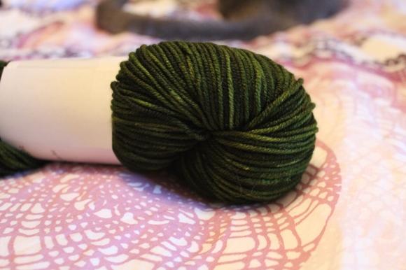 Treasure Goddess yarn in a rich semisolid forest green