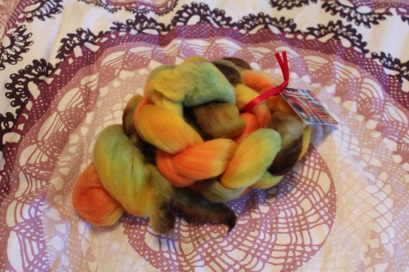 Orange, yellow, green, and brown roving from Topeka Twister