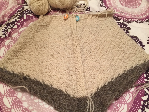 Two sweater fronts in progress, knitted at the same time