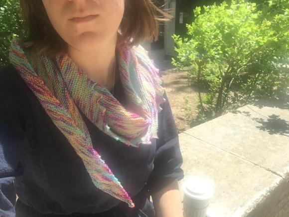 Woman wearing a Hitchhiker shawl