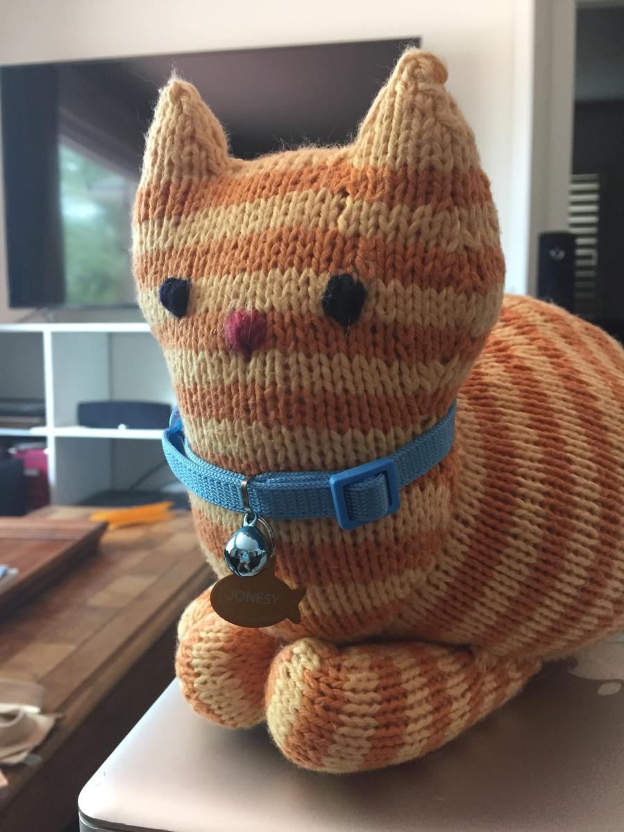 Knitted orange tabby Parlor Cat with Jonesy collar