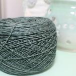 Cake of blue-green yarn dyed by Gherkin's Bucket