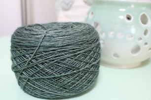 Cake of blue-green yarn dyed by Gherkin's Bucket