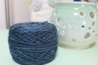 Cake of sparkly blue yarn dyed by Gherkin's Bucket