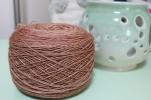 Cake of tan yarn dyed by Gherkin's Bucket