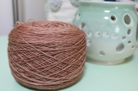 Cake of tan yarn dyed by Gherkin's Bucket