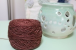 Cake of reddish-brown yarn dyed by Gherkin's Bucket