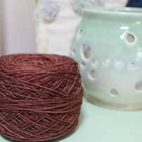 Cake of reddish-brown yarn dyed by Gherkin's Bucket
