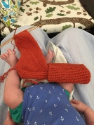 Rick and Roll sock in orange Quince and Co Finch yarn with baby feet