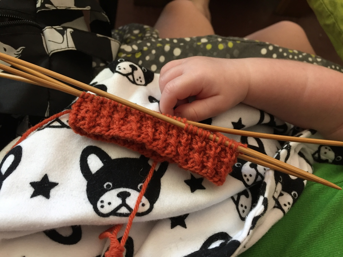 Cuff of a Rick and Roll sock by Hands Occupied with a baby hand