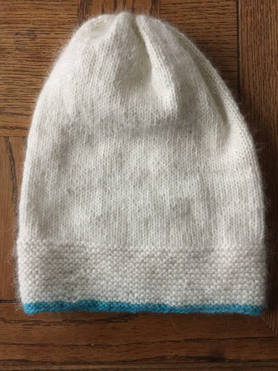 Grann hat knitted with white Belangor mohair and a stripe of ice blue