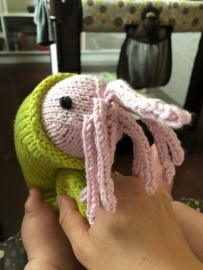 Knitted Nautie toy in lime and pink