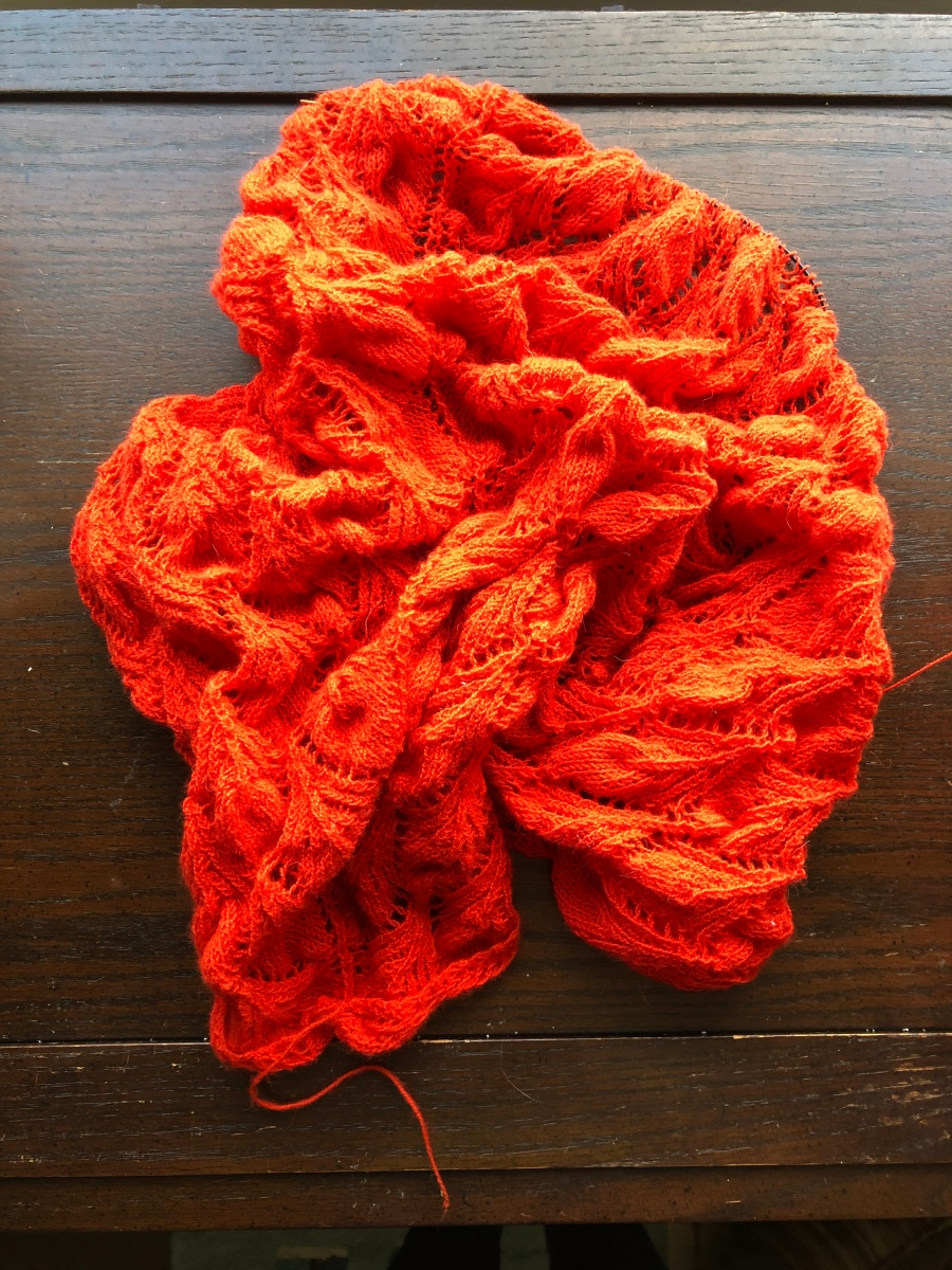 Balled up Fantoosh! shawl in bright orange Shibui Cima