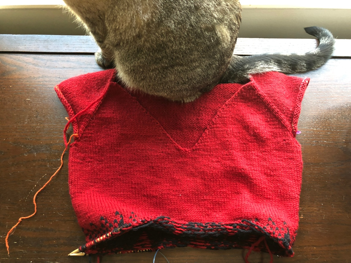 Red and black From Another Place pullover in progress with Eloise cat butt