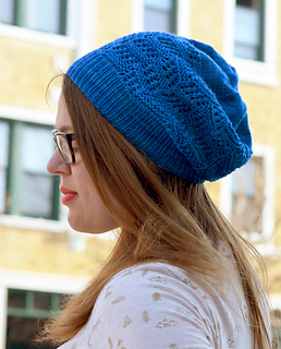 Image of Laura McDougal wearing her Bowdoin Hat on a city street, image copyright Holla Knits
