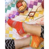 Picture of Jelly Roll socks by Mara Catherine Bryner modeled on feet, image copyright Mara Catherine Bryner